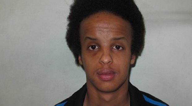 Police are trying to trace Mahamed Barre in connection with the murder of Jamil Palmer, who was stabbed to death in a park in Feltham, west London (Met Police/PA)