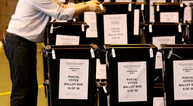 Postal vote manager for the European Elections for Edinburgh Donald Burgess moves ballot boxes filled with postal votes