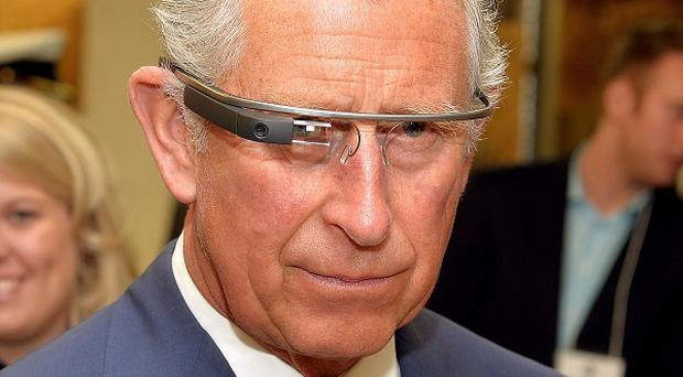 The Prince of Wales tries on Google Glass on the final day of his trip to Canada.