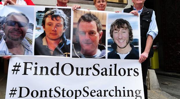 The families of four missing sailors have been told the search would be suspended at midnight.