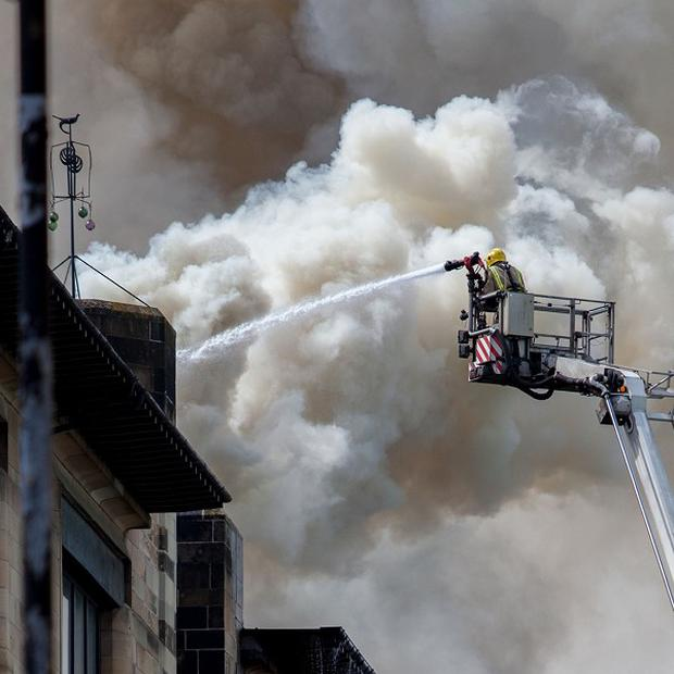 Firefighters tackle the blaze at Glasgow School of Art's Charles Rennie Mackintosh building (PA/David Barz)