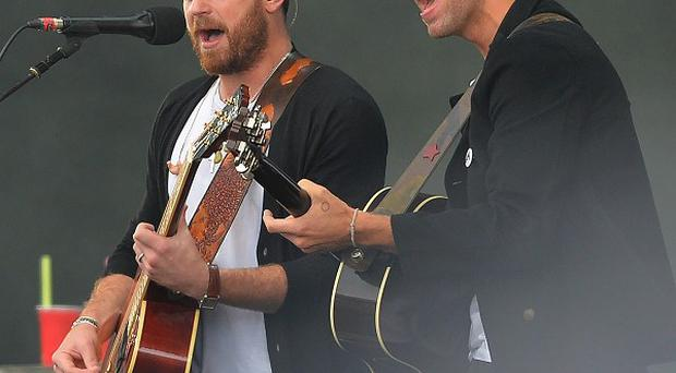 Chris Martin (right) of Coldplay performing with The Kings of Leon during Radio 1's Big Weekend at Glasgow Green, Glasgow.