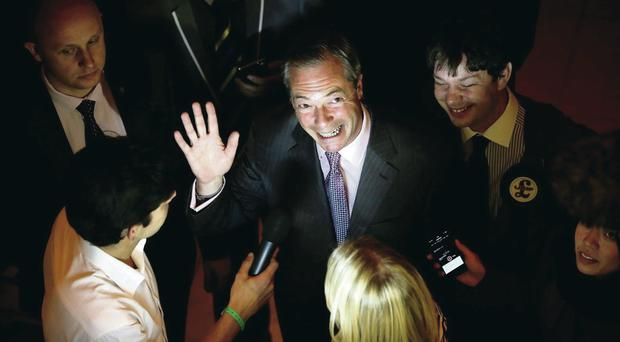 Leading light: UKIP leader Nigel Farage is surrounded by media as he arrives for the South East count yesterday