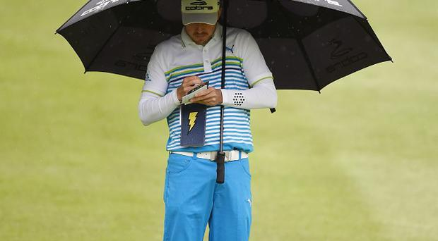 Sweden's Jonas Blixt shelters from the rain