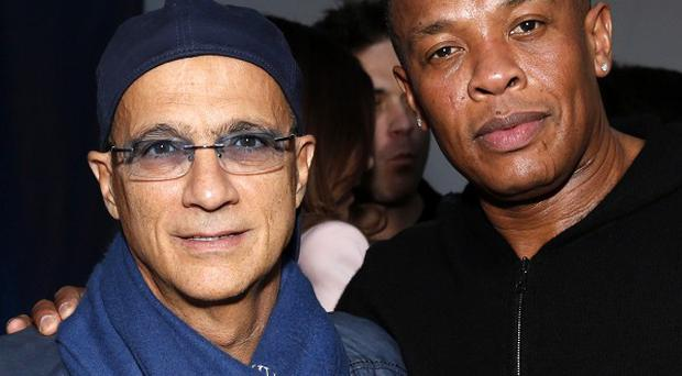 Jimmy Iovine and Dr Dre founded Beats Electronics in 2008 and it now dominates the luxury headphones market (AP)