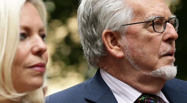 Rolf Harris arriving at court with daughter Bindi.