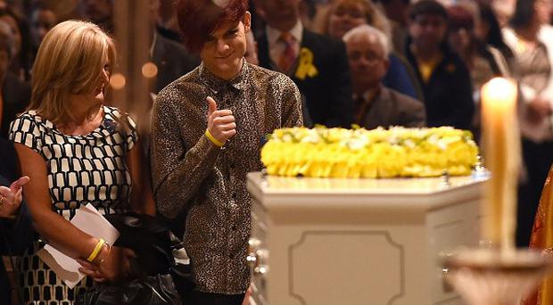 Stephen Sutton's brother Chris gives a thumbs up as Stephen's coffin stands in Lichfield Cathedral during the vigil in his memory
