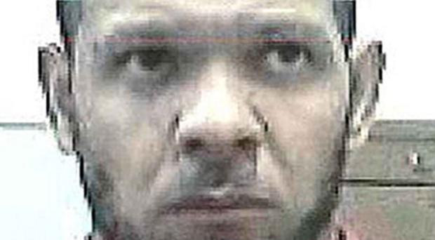 Simon Rhodes-Butler, a violent robber who has gone missing - the latest in a series of prisoners to have recently gone on the run from an open jail