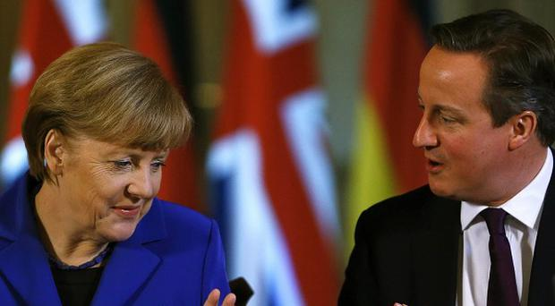 David Cameron issued his warning to Angela Merkel at the EL leaders summit in Brussels, it was reported