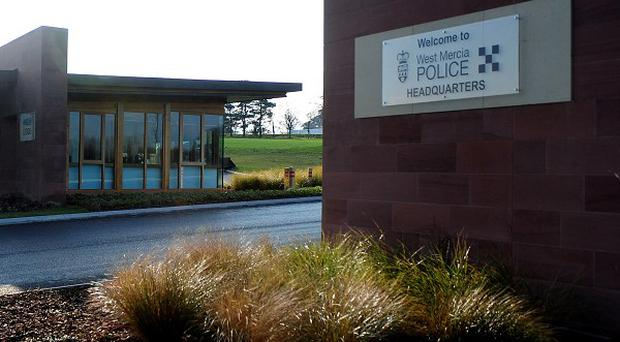West Mercia Police were called after two dogs attacked and injured a woman