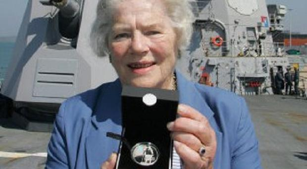 Lady Mary Soames, daughter of Sir Winston Churchill, has died aged 91. She is pictured holding a coin commemorating her father aboard the USS Winston S Churchill which was docked in Portsmouth.