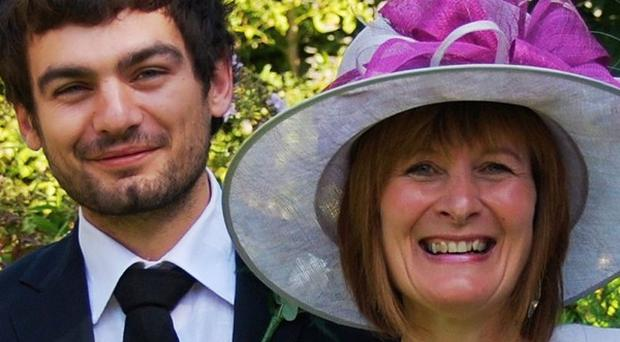 Janet Southwell, pictured with her son Gareth Huntley, has flown out to Malayasia to join the search for him