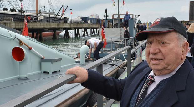 Basil Woolf, 91, from Dunedin, Florida, looks at the MGB81 which took part in the D-Day landings carrying British and Canadian troops to Sword Beach, during a visit to Portsmouth Historic Dockyard