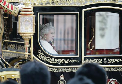 The Queen sets off for Parliament for the first time in the new Diamond Jubilee State coach