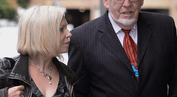 Veteran entertainer Rolf Harris arrives with daughter Bindi at London's Southwark Crown Court, where he denies 12 counts of indecent assault between 1968 and 1986