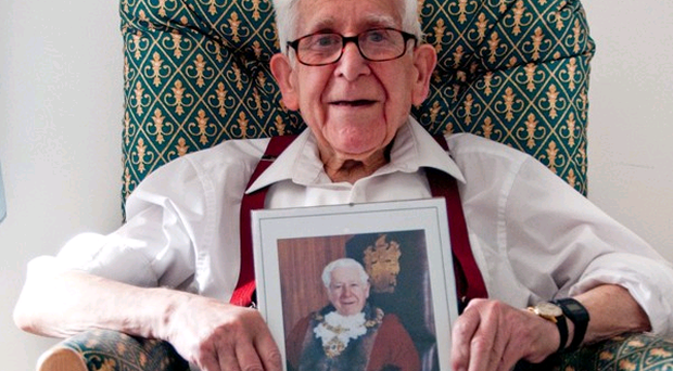 Bernard Jordan an 89-year-old veteran, holding a picture of himself as the Mayor of Hove from 1995 to 1996.
