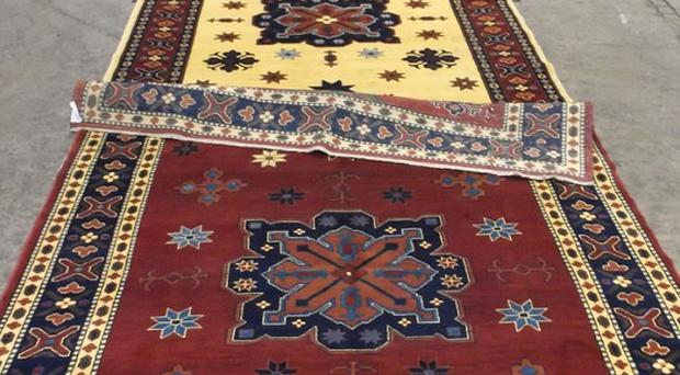 Rugs that were seized by Border Force at Manchester Airport, as sniffer dogs found millions of pounds worth of heroin woven into the hand-made rugs (Border Force/PA)