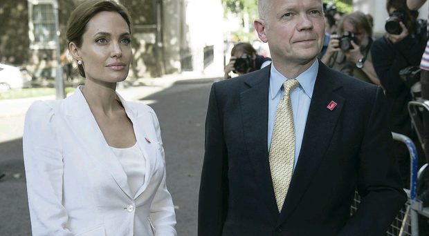 Angelina Jolie outside Downing Street with Foreign Secretary William Hague yesterday