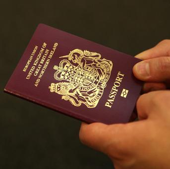 Ministers have stepped in to prevent officials relaxing checks on overseas applicants for British passports as they scramble to deal with a backlog of at least 30,000 applications.
