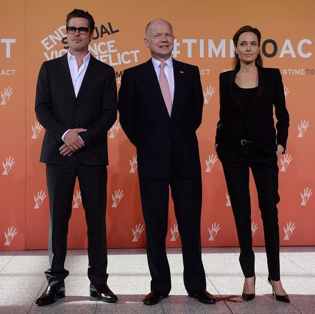 Foreign Secretary William Hague (centre), Brad Pitt and Angelina Jolie arrive at the End Sexual Violence in Conflict Summit at the Excel centre in east London.