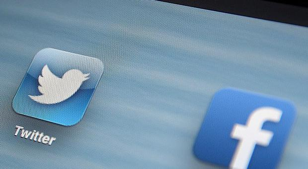 A legal loophole means Facebook status updates and Twitter posts are being monitored by the UK Government