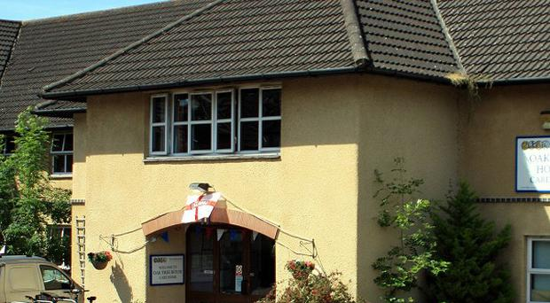 A man has been charged with the murder of an elderly woman at the Oaktree House care home in Yate, South Gloucestershire