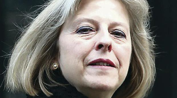 Powers plea: Theresa May