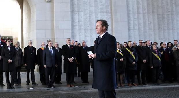 David Cameron in Ypres last December - he will return with other EU leaders to mark the 100th anniversary of the First World War (AP)