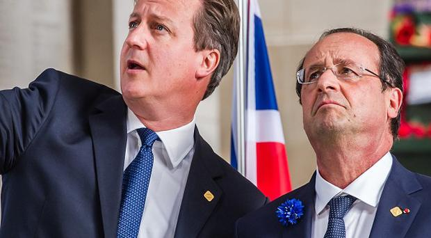 Prime Minister David Cameron, left, with French President Francois Hollande during a ceremony to mark the centenary of the First World War in Ypres (AP)