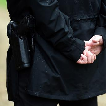 Armed police are searching for a man in Cornwall
