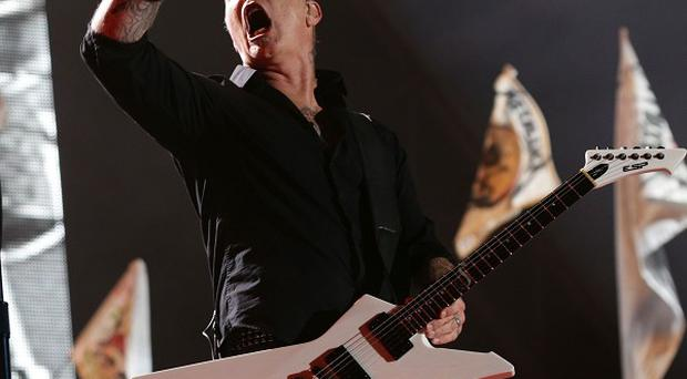 James Hetfield of Metallica performing on the Pyramid Stage at the Glastonbury Festival