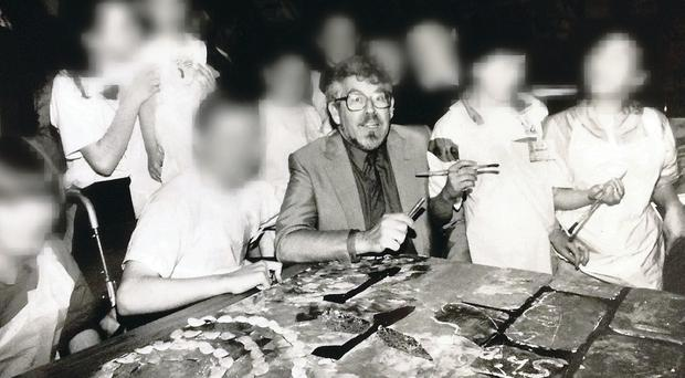 Harris in Belfast at an art workshop for 100 children at Shankill Leisure Centre in June 1991. Their faces have been obscured