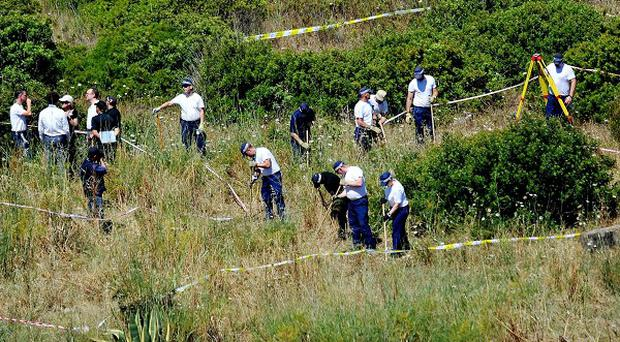British police and their Portuguese counterparts investigating the disappearance of Madeleine McCann during an earlier search of a patch of scrubland just outside Praia da Luz.