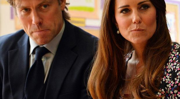 Kate is visiting the Blessed Sacrament School with comedian John Bishop