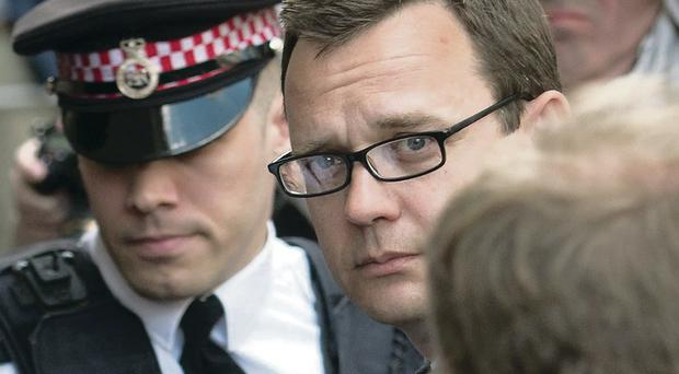Andy Coulson arrives in court for sentencing yesterday