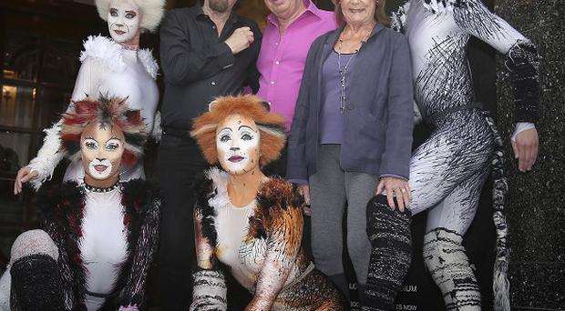 Trevor Nunn, Andrew Lloyd Webber and Gillian Lynne with performers from the musical Cats outside the London Palladium