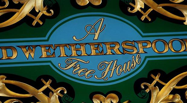 A JD Wetherspoon logo, as the pub chain is to cut the opening times of its outlets at the weekends in response to late-night levies being introduced by local councils
