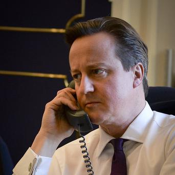 File photo of Prime Minister David Cameron talking on the telephone to US President Barack Obama on the situation in Ukraine, from his office at 10 Downing Street.