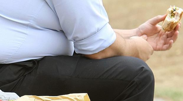Losing weight and eating healthily cuts the risk of developing dementia or disability, experts say