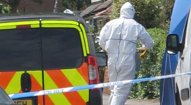The probe comes after two people were found fatally stabbed at an address in the West Midlands