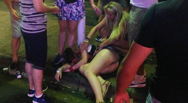 Revellers on the Punta Ballena strip in Magaluf after a night out
