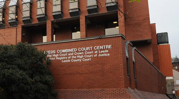 Pc Suzanne Hudson was shot after she knocked on a door, Leeds Crown Court has been told