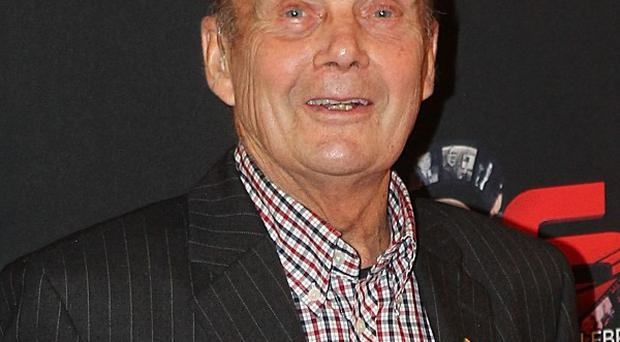 Cycling legend Brian Robinson, 83, is in hospital after a collision while on his bike