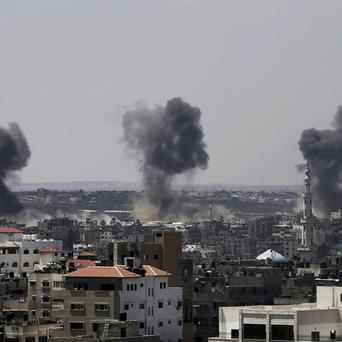 Smoke rises after Israeli missile strikes hit the northern Gaza Strip (AP)