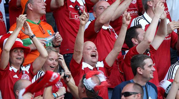 Denmark football fans display the exuberance which saw the country named the most happy on earth