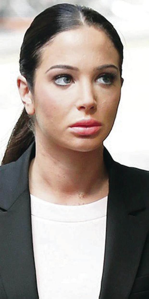 Accused: Tulisa at court yesterday