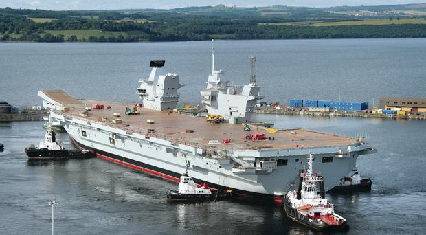 HMS Queen Elizabeth,the largest warship ever built in the UK, during her float out of the dock at Fife's Rosyth Dockyard