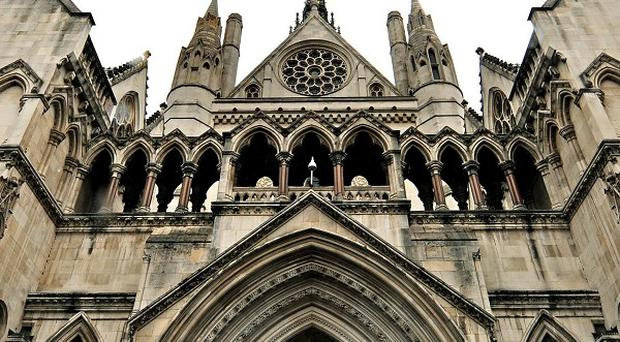 Moves to deport a convicted killer have been blocked by the High Court
