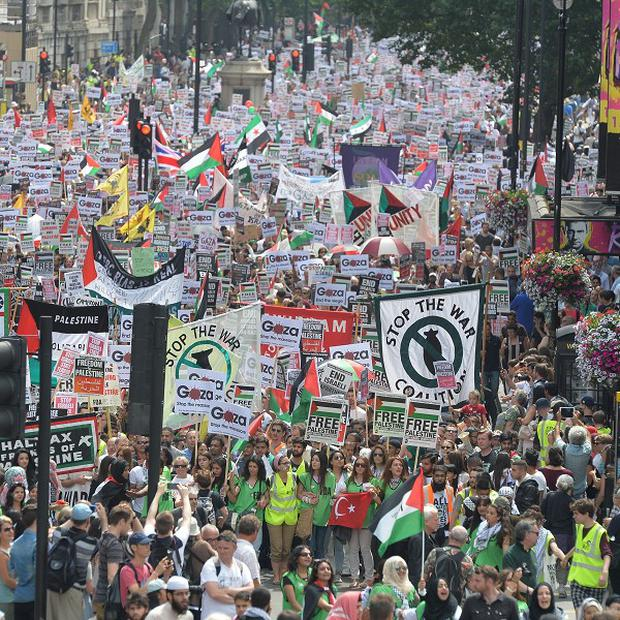 Thousands of protesters march through Whitehall in central London, to call for an end to Israeli military action in Gaza