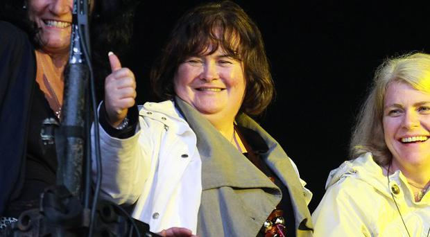 Singer Susan Boyle is to carry the Queen's baton during its journey around Glasgow